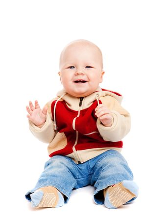 laughing baby: Laughing baby boy sits clapping, isolated