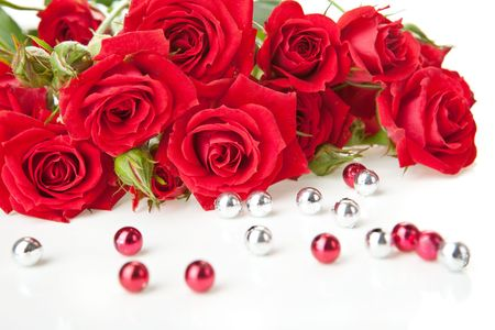 rose petal: Red roses bouquet and beads on white background