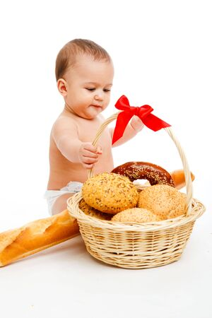 Cute baby in diaper with the bread basket photo