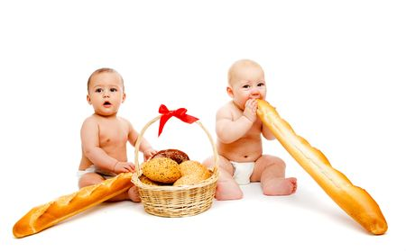 french bread rolls: Two baby friends in diaper with bread