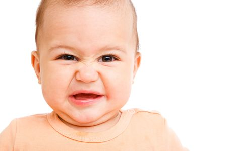 molesto: Retrato de un beb� con la expresi�n facial de disgusto