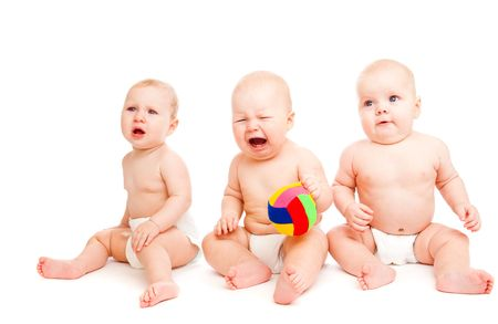 Three sad babies in diapers, isolated photo