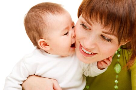 Portrait of a cute baby kissing mother photo