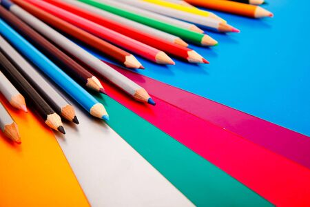 Colorful pencils lying on colorful cardboard sheets Stock Photo - 6265889