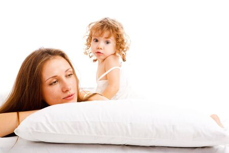 Astonished toddler and mother lying on the pillow Stock Photo - 6264711
