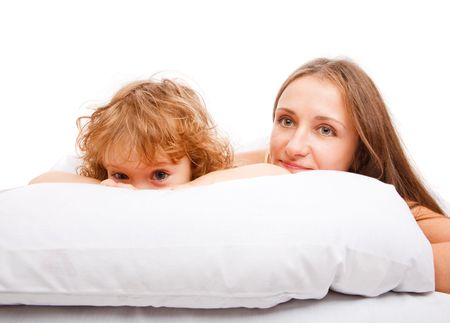 Beautiful mother and daughter lying on the pillow Stock Photo - 6264764