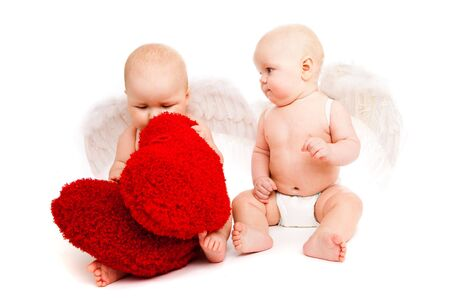 Two angelic baby friends in white diapers photo
