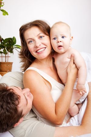Lovely happy family in the bedroom photo