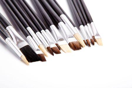 Set of artistic brushes isolated over white photo