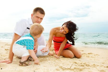 Parents and their offspring playing at the beach Stock Photo - 6288247