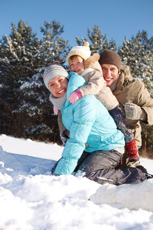 winter wood: Parents playing with their toddler daughter in a winter wood