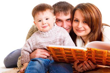 Parents reading a book to their lovely kid Stock Photo - 6453544