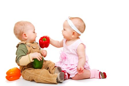 Baby couple eating peppers Stock Photo - 6453506