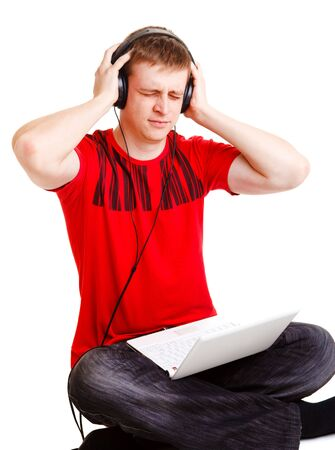 Man seems to hate the music he hears in headphones Stock Photo - 6453517