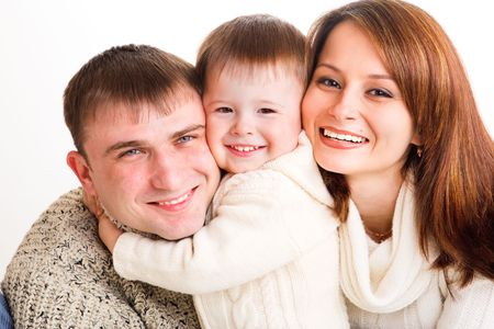 Beautiful  and happy young family, isolated photo