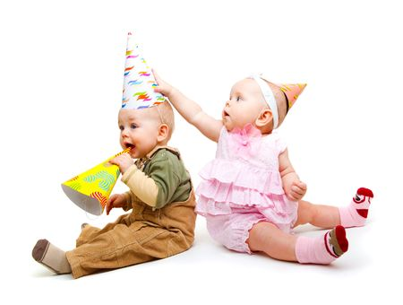 Two lovely kids with party hats on, isolated Stock Photo - 6453548