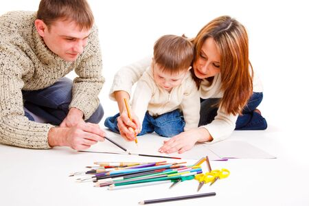 Parents drawing together with  their toddler son Stock Photo - 6453547