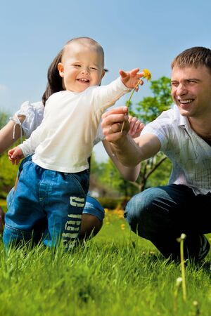 Dad giving flower to his son Stock Photo - 6536845