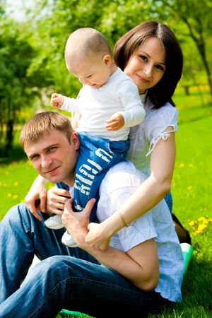 Young family in a sunny spring park photo