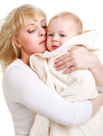 Mom embracing her beautiful baby son covered with towel Stock Photo - 6553670