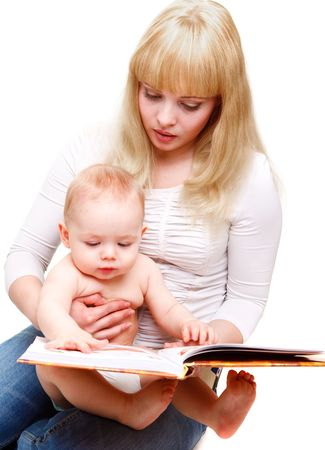 Mom reading a book to her baby son photo