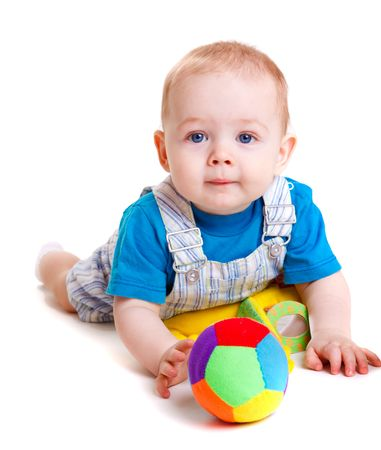 Sweet infant lying with toys in front of him  photo