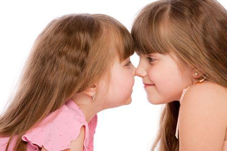 Portrait of two lovely preschool girls, over white photo