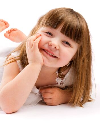 Portrait of a sweet laughing preschool girl photo