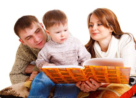 Parents reading a book to their lovely kid Stock Photo - 6838636