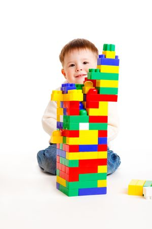 Toddler building a high tower, isolated Stock Photo