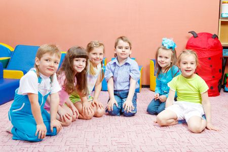 Six friendly kids sitting in the kindergarten Stock Photo - 6838651