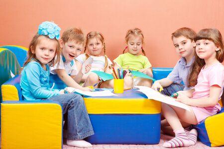 A group of cute preschool children enjoying their art and craft activities Stock Photo - 6838743