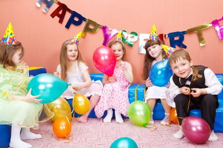 Group of preschool kids at the birthday party photo