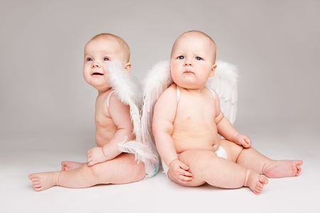 Two angelic baby friends in white diapers Stock Photo - 6899610