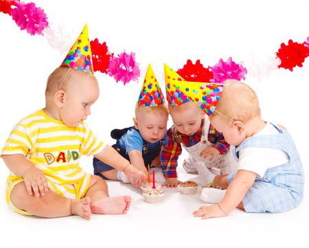 Adorable babies taking birthday cakes with candles photo