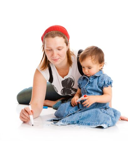 Mom writing, daughter looking at her, isolated photo