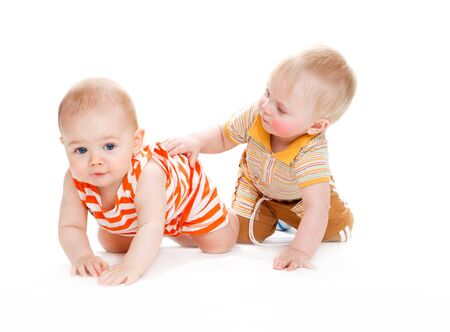 interested baby: Two kids crawling, isolated Stock Photo