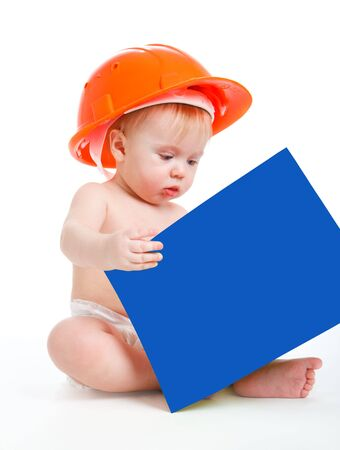 Baby in the orange hardhat reading a book photo