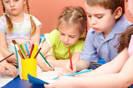 Preschool kids drawing photo