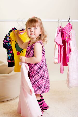 A sweet toddler girl trying on clothes Stock Photo - 6899489