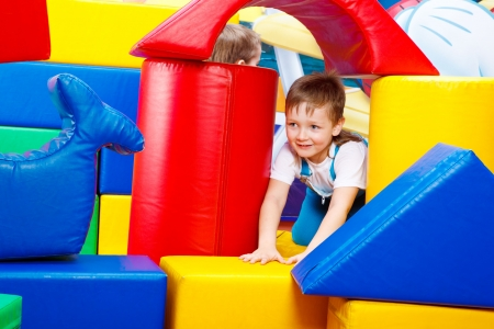 A preschool boy playing in the large bricks tower Stock Photo - 6899099