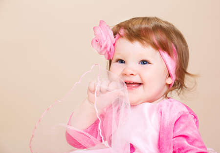 Portrait of a sweet baby girl, laughing Stock Photo - 6899096