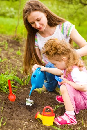 Mother and daughter working  in the garden Stock Photo - 7001583