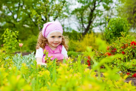 A sweet curly girl in the garden Stock Photo - 7020847