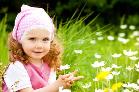 Happy girl  on the meadow with white flowers Stock Photo - 7020843