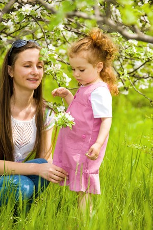 Mother and daughter under the apple tree photo