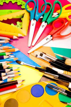 Colorful pencils lying on colorful cardboard sheets photo