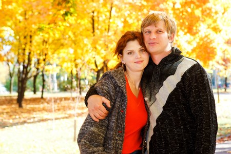 Man and woman in the autumn park photo