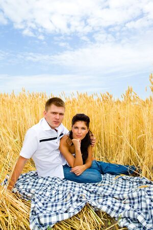 Man and woman in a wheat field photo