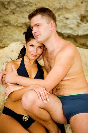 Portrait of a couple sitting on the rocks photo